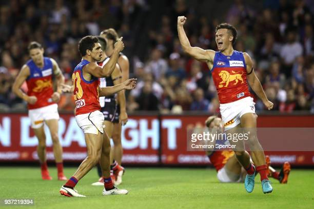 Charlie Cameron of the Lions celebrates kicking a goal with team mate Cameron Rayner of the Lions during the round one AFL match between the St Kilda...