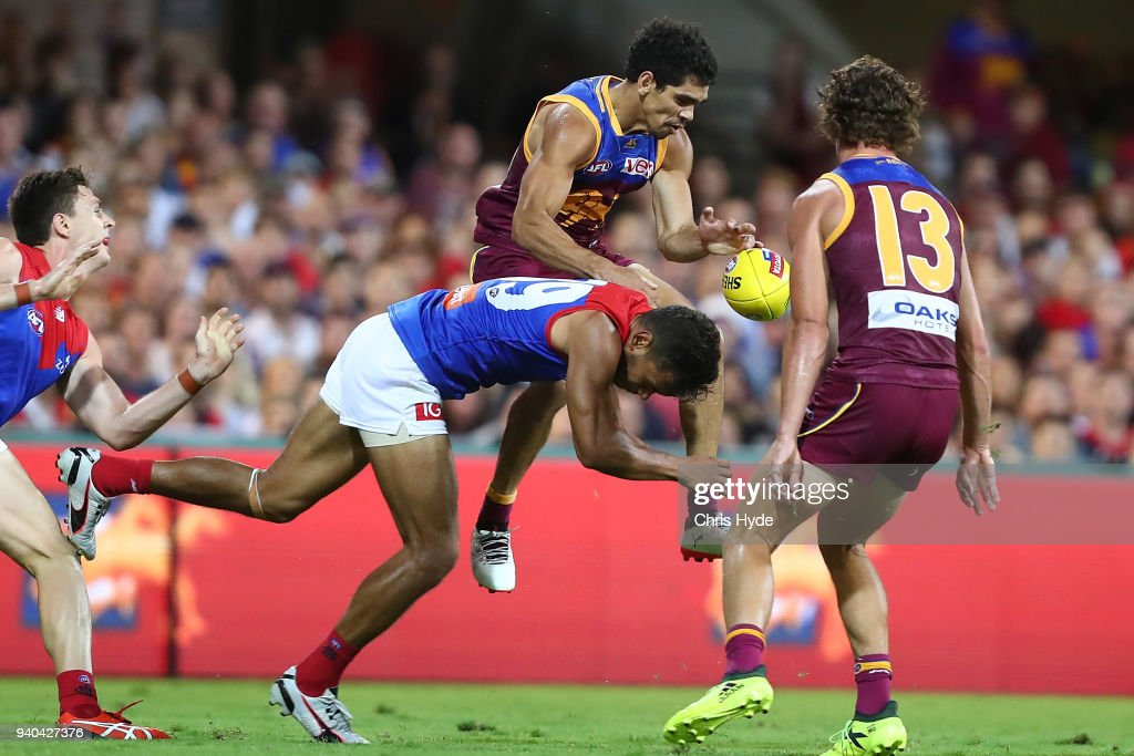 Charlie Cameron of the Lions is tackled during the round two AFL match between the Brisbane Lions and the Melbourne Demons at The Gabba on March 31, 2018 in Brisbane, Australia.