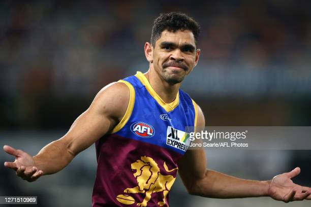 Charlie Cameron of the Lions shrugs after kicking a goal during the round 16 AFL match between the Brisbane Lions and the Gold Coast Suns at The...