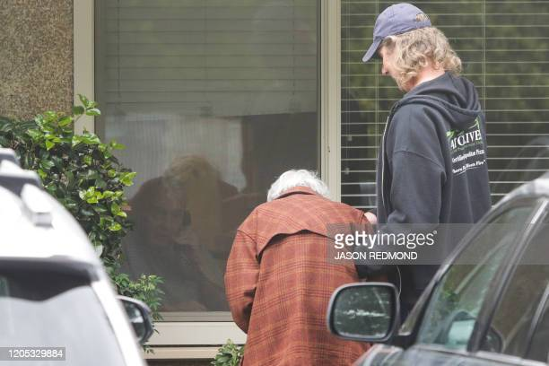 Charlie Campbell a retired RN from Silver City New Mexico takes his mom Dorothy Campbell of Bothell to see her husband Gene Campbell through his room...