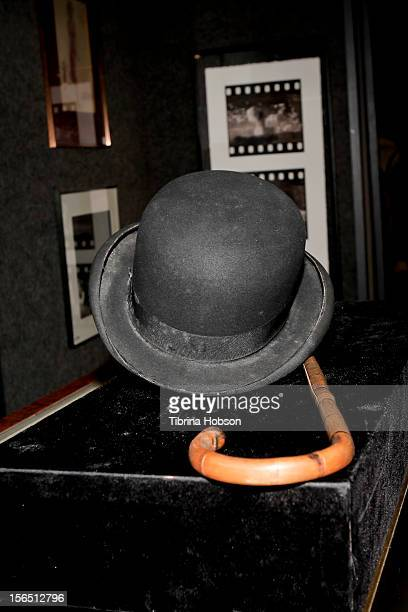 Charlie Chaplain's iconic bowler hat and cane on display during the Bonhams media preview day for memorabilia of silver screen and rock n' roll icons...