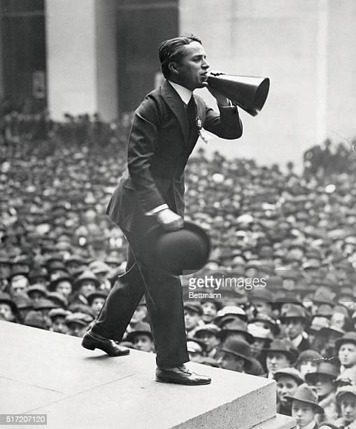Charlie Chaplin addressing crowds via megaphone on steps of Sub Treasury Building in New York during World War I rally