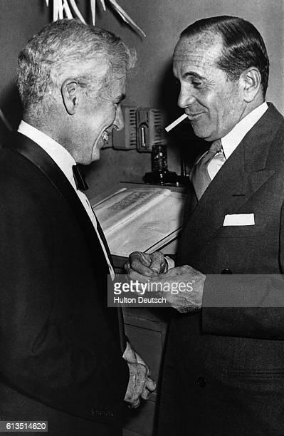 Charlie Chaplin and Al Jolson legends of the movie screen meet and talk at a New York nightclub March 1947   Location El Morocco Night Club New York...