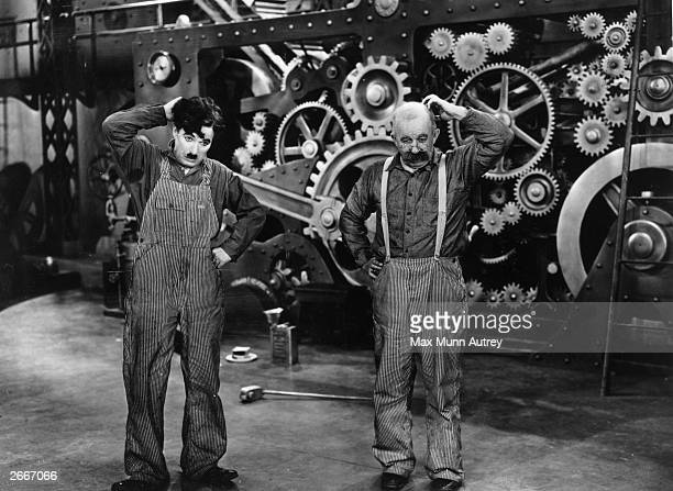 Charlie Chaplin and Chester Conklin star in the silent comedy 'Modern Times' directed by Chaplin himself