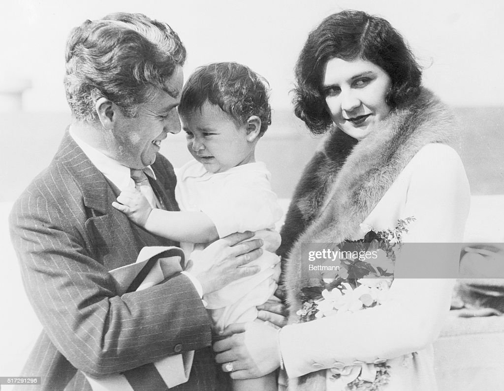 Charlie Chaplin (1889 - 1977) and Family. This is the first time photographers were able to get a picture of the famous movie comedian, his second wife, Lita Grey (1908 - 1995) and their baby son, Charles Jnr (1925 - 1968). It was taken on board the SS City of Los Angeles in November 1926, when Mrs. Chaplin and Charles Spencer Jr., sailed from Los Angeles for Honolulu and the Senior Charlie came down to the boat to see them off.