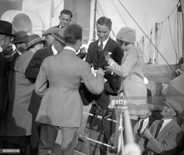 Charlie Chaplin arrives and signs autographs on the Olympic