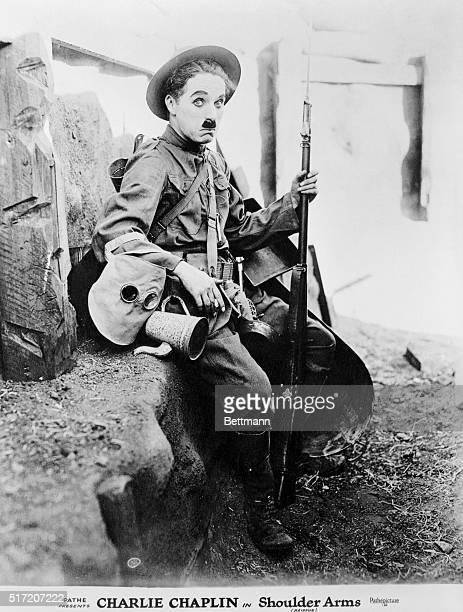 Charlie Chaplin as the recruit inhis 1918 film Shoulder Arms set in the trenches of WWI