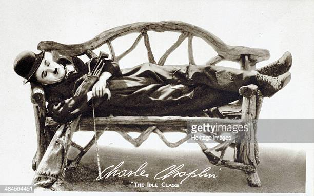 Charlie Chaplin comedian and actor c1921 Chaplin asleep on a bench cradling a bag of golf clubs in his arms Photograph promoting the motion picture...