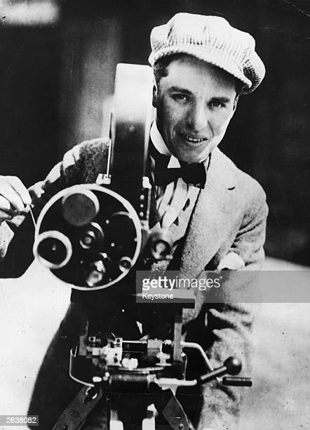 Charlie Chaplin English film actor and director operating a movie camera Original Publication People Disc HW0474