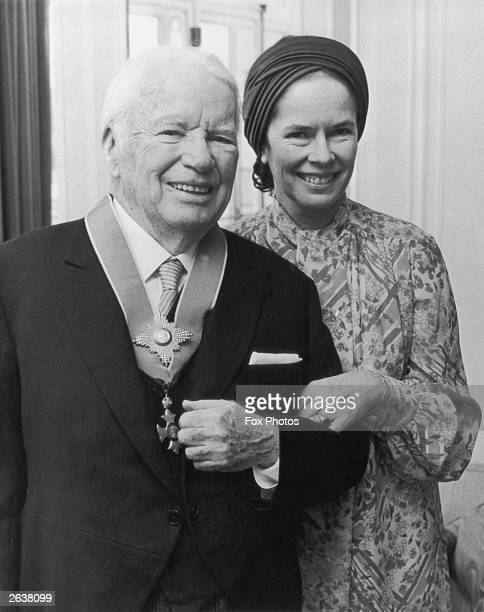Charlie Chaplin English film actor and director with his wife Oona O'Neill after receiving a Knighthood from Queen Elizabeth II at Buckingham Palace...