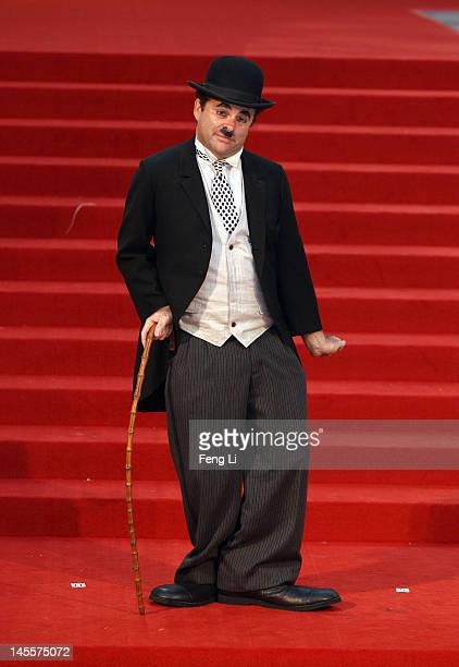 Charlie Chaplin impersonator performs outside the the Montblanc Sanlitun Concept Store during the Montblanc international gala to celebrate the...