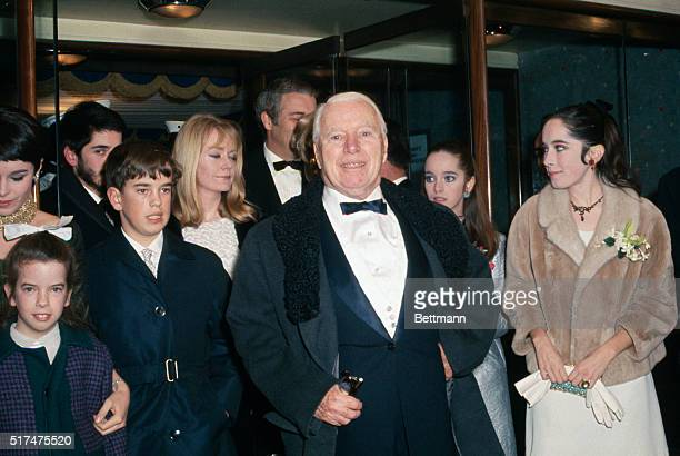 Charlie Chaplin is shown at premiere of film The Countess of Hong Kong along with family members Josephine Victoria Michael Geraldine Eugene Jane and...