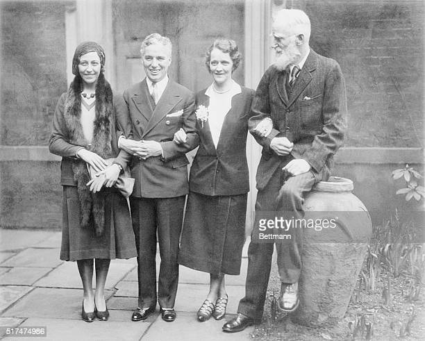 Charlie Chaplin Lunches with Lady Astor London England Here is Charlie Chaplin premier screen comedian in the company of some of England's most...
