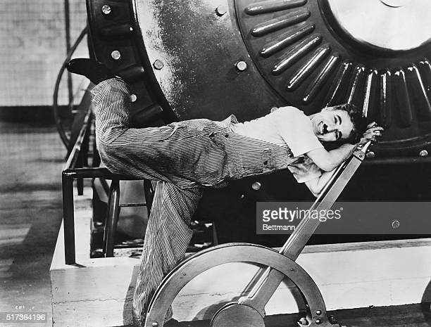 Charlie Chaplin working machinery in Modern Times a film of humor and social commentary released in 1936