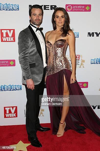 Charlie Clausen and Cassie Howarth arrive at the 2014 Logie Awards at Crown Palladium on April 27 2014 in Melbourne Australia