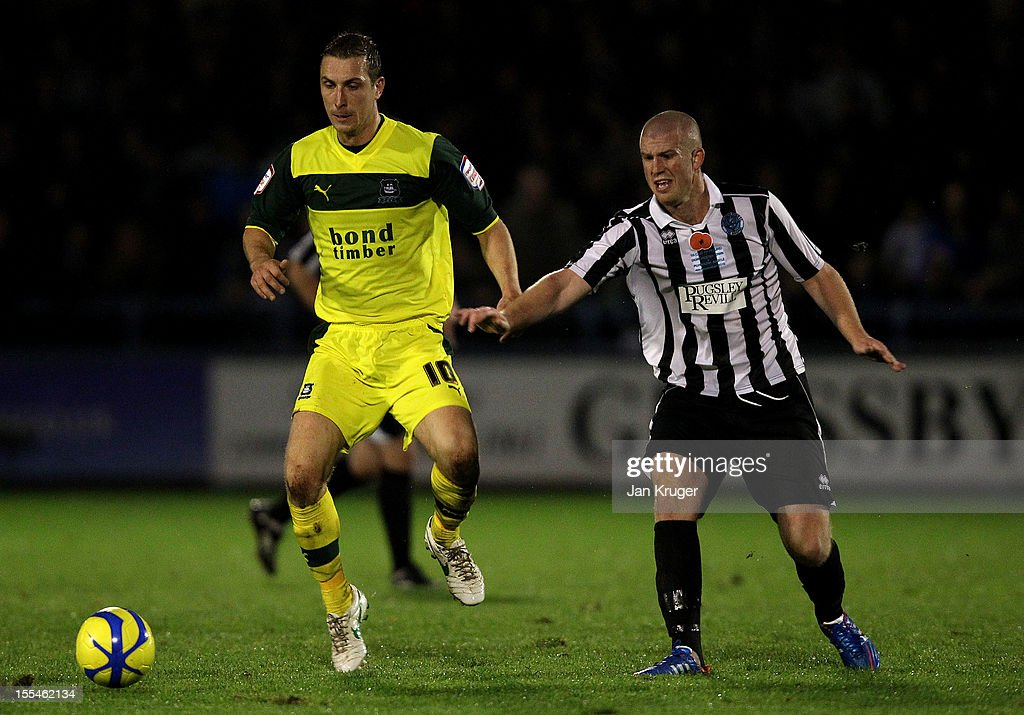 Charlie Clough of Dorchester Town competes with Rhys Griffiths of Plymouth Argyle during the FA Cup with Budweiser 1st Round match between Dorchester Town and Plymouth Argyle at The Avenue Stadium on November 4, 2012 in Dorchester, England.
