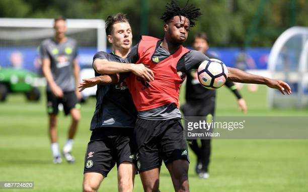 Charlie Colkett of Chelsea and Nathaniel Chalobah of Chelsea battle for possession during a Chelsea training session at Chelsea Training Ground on...