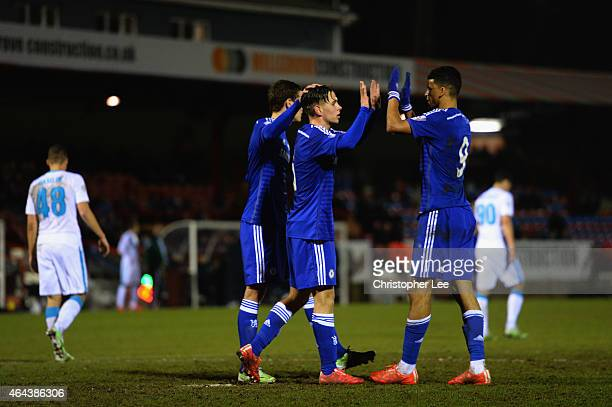 Charlie Colkett of Chelsea celebrates scoring their third goal from the penalty spot with Dominic Solanke during the Round of 16 in the UEFA Youth...