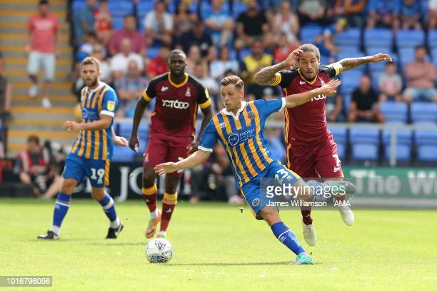 Charlie Colkett of Shrewsbury Town and Sean Scannell of Bradford City during the Sky Bet League One match between Shrewsbury Town and Bradford City...