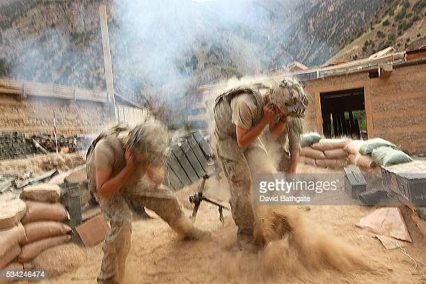 Charlie Company troops of the US Army's 10th Mountain Division fire mortars on Taliban mountain side positions near the town of Barge Matal Nuristan...