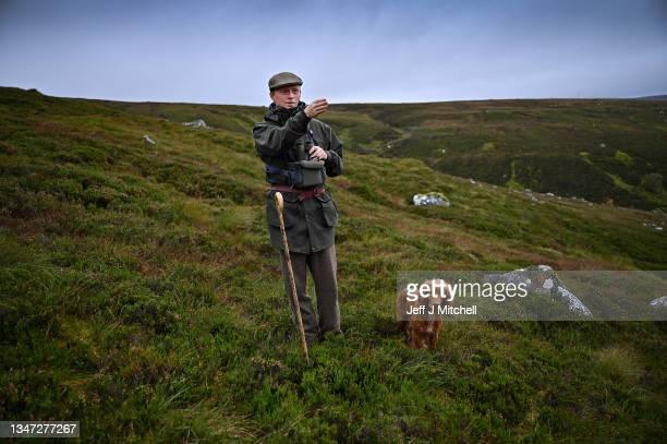 Charlie Connell stalks red deer stags in Glen Markie on Stronelairg on October 18, 2021 on the grounds of the Garrogie Estate near Whitebridge, south...