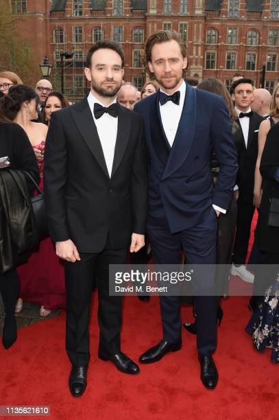 Charlie Cox and Tom Hiddleston attend The Olivier Awards 2019 with Mastercard at The Royal Albert Hall on April 7 2019 in London England