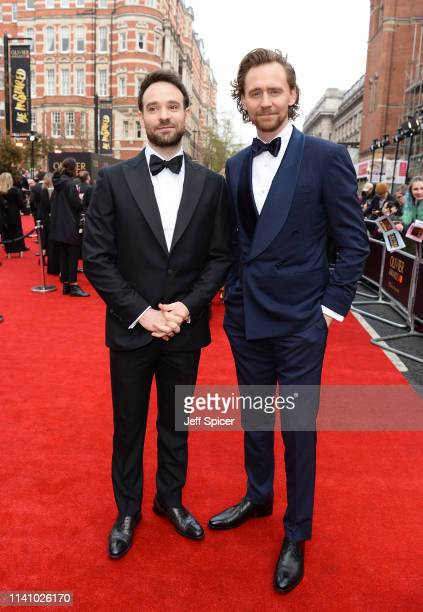 Charlie Cox and Tom Hiddleston attend The Olivier Awards with Mastercard at the Royal Albert Hall on April 07 2019 in London England