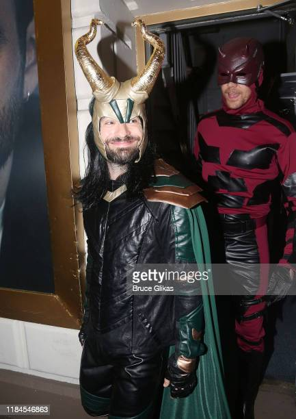 Charlie Cox as Loki and Tom Hiddleston as Daredevil greet fans as the Broadway cast of Betrayal celebrate Halloween at The Bernard B Jacobs Theatre...