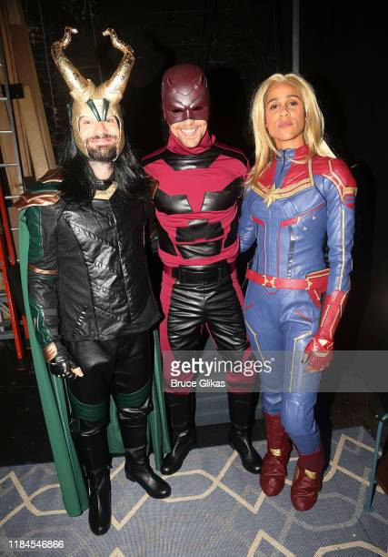 Charlie Cox as Loki Tom Hiddleston as Daredevil and Zawe Ashton as Captain Marvel pose as the Broadway cast of Betrayal celebrate Halloween at The...