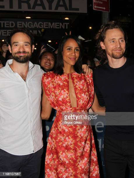 Charlie Cox Zawe Ashton and Tom Hiddleston greet and sign autographs for fans after the first public preview of Harold Pinter's classic play...