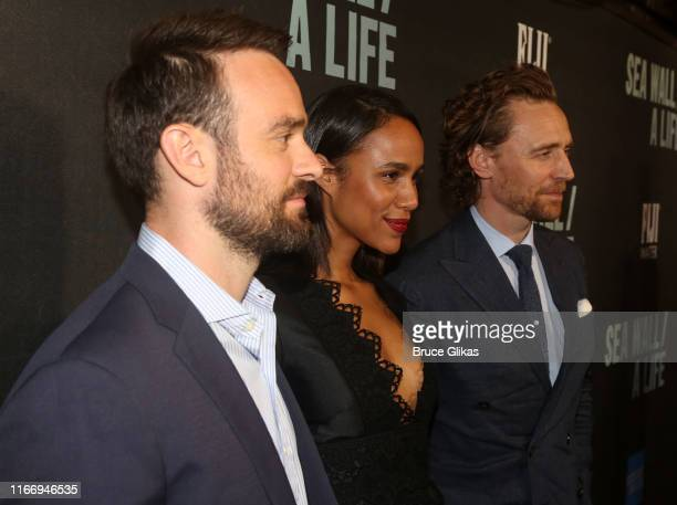 Charlie Cox Zawe Ashton and Tom Hiddleston pose at the opening night of Sea Wall/A Life on Broadway at The Hudson Theatre on August 8 2019 in New...