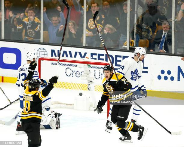 Charlie Coyle and Marcus Johansson of the Boston Bruins celebrate their goal against the Toronto Maple Leafs in the first period of Game Seven of the...