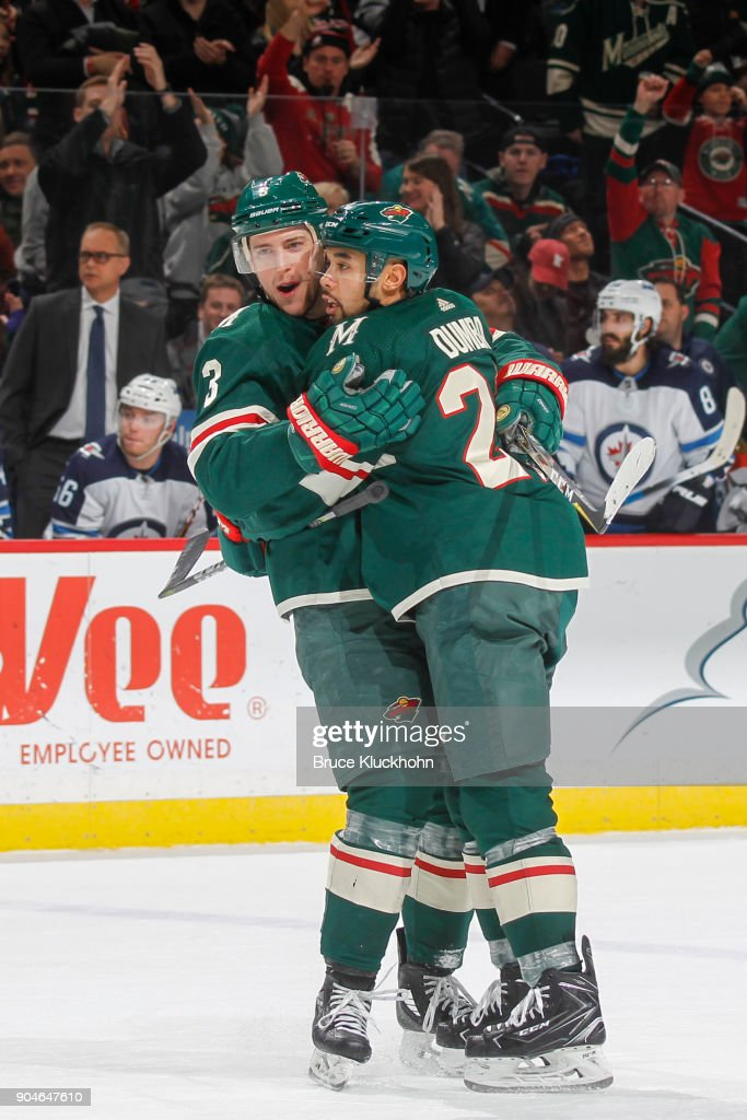 Charlie Coyle #3 and Matt Dumba #24 of the Minnesota Wild celebrate after scoring a goal against the Winnipeg Jets during the game at the Xcel Energy Center on January 13, 2018 in St. Paul, Minnesota.