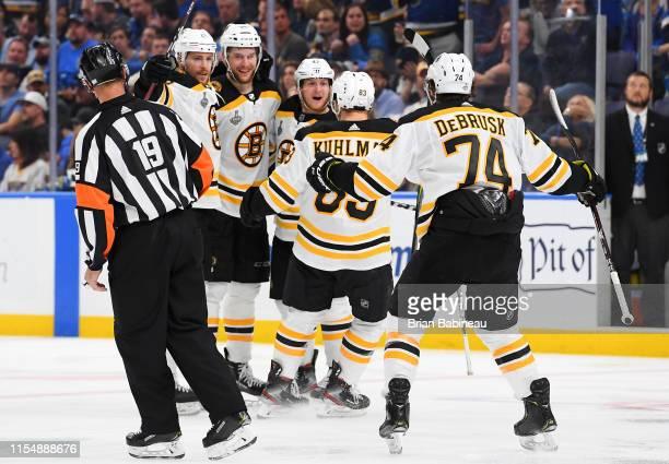 Charlie Coyle Brandon Carlo Torey Krug Karson Kuhlman and Jake DeBrusk of the Boston Bruins celebrate Carlo's goal during the third period of Game...