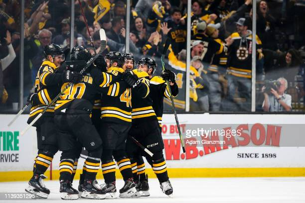 Charlie Coyle of the Boston Bruins celebrates with teammates after scoring in overtime to beat the Columbus Blue Jackets in Game One of the Eastern...