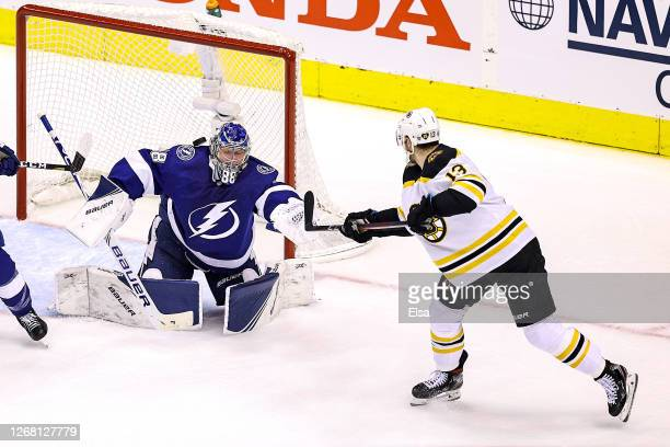 Charlie Coyle of the Boston Bruins deflects a shot for a goal past Andrei Vasilevskiy of the Tampa Bay Lightning at 1852 during the first period in...