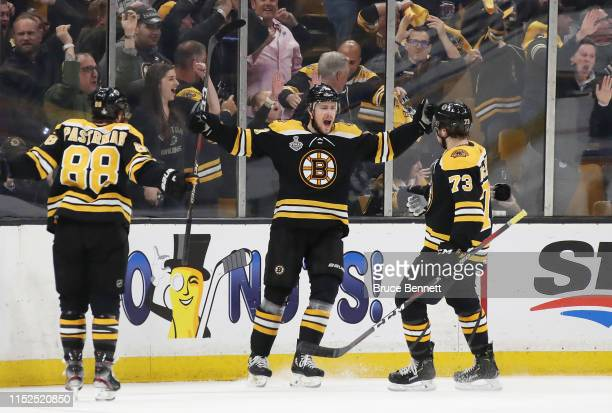 Charlie Coyle of the Boston Bruins is congratulated by his teammates David Pastrnak and Charlie McAvoy after scoring a first period goal against the...