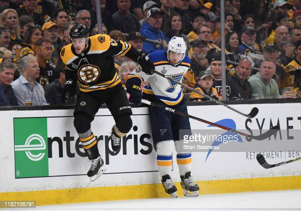 Charlie Coyle of the Boston Bruins jumps up against Ivan Barabashev of the St Louis Blues during the Stanley Cup Final at the TD Garden on May 26...