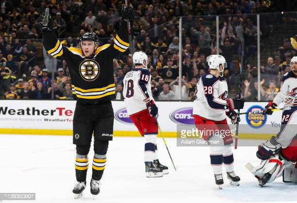 Charlie Coyle of the Boston Bruins reacts after scoring a goal in the third period against the Columbus Blue Jackets in Game One of the Eastern...