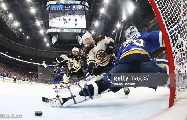 Charlie Coyle of the Boston Bruins scores a first period goal at 1314 past Jordan Binnington of the St Louis Blues in Game Four of the 2019 NHL...