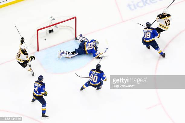 Charlie Coyle of the Boston Bruins scores a first period goal past Jordan Binnington of the St Louis Blues in Game Three of the 2019 NHL Stanley Cup...