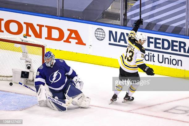 Charlie Coyle of the Boston Bruins scores a goal past Andrei Vasilevskiy of the Tampa Bay Lightning during the first period in Game One of the...