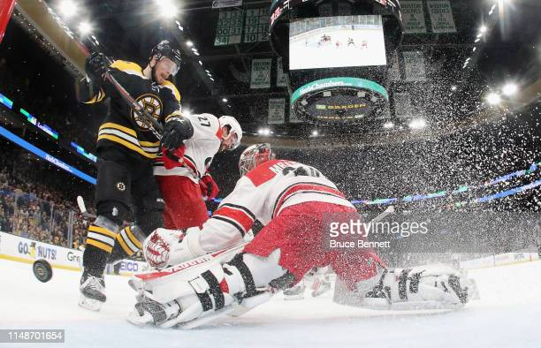 Charlie Coyle of the Boston Bruins scores a second period goal against Petr Mrazek of the Carolina Hurricanes in Game Two of the Eastern Conference...