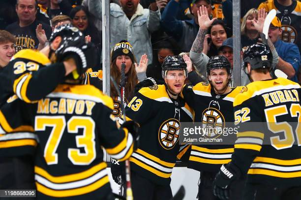 Charlie Coyle of the Boston Bruins scores in the first period of a game against the Vancouver Canucks at TD Garden on February 4, 2020 in Boston,...