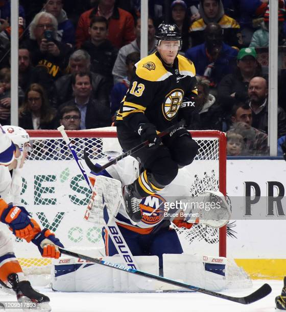 Charlie Coyle of the Boston Bruins screens Semyon Varlamov of the New York Islanders during the second period at NYCB Live's Nassau Coliseum on...