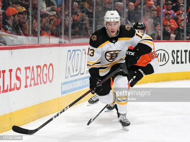 Charlie Coyle of the Boston Bruins skates against Justin Braun of the Philadelphia Flyers on March 10 2020 at the Wells Fargo Center in Philadelphia...
