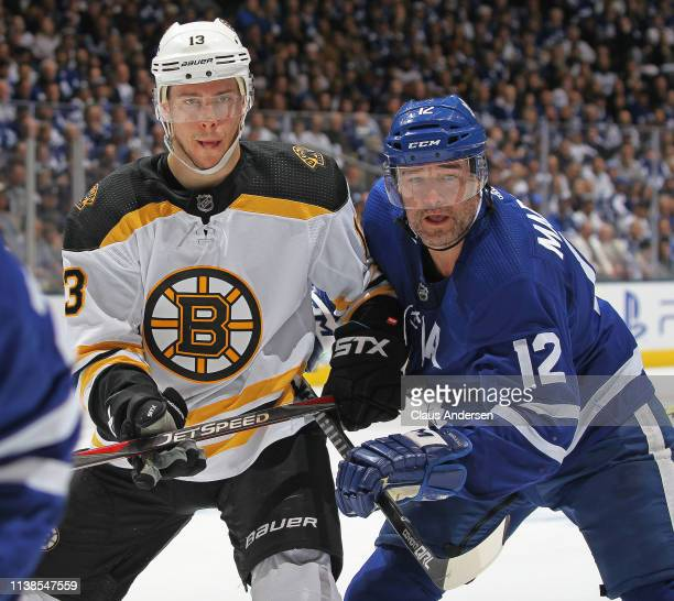 Charlie Coyle of the Boston Bruins skates against Patrick Marleau of the Toronto Maple Leafs in Game Six of the Eastern Conference First Round during...