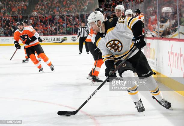 Charlie Coyle of the Boston Bruins skates the puck against the Philadelphia Flyers on March 10 2020 at the Wells Fargo Center in Philadelphia...