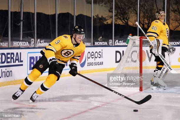 Charlie Coyle of the Boston Bruins skates with the puck past goaltender Tuukka Rask during the 'NHL Outdoors At Lake Tahoe' against the Philadelphia...