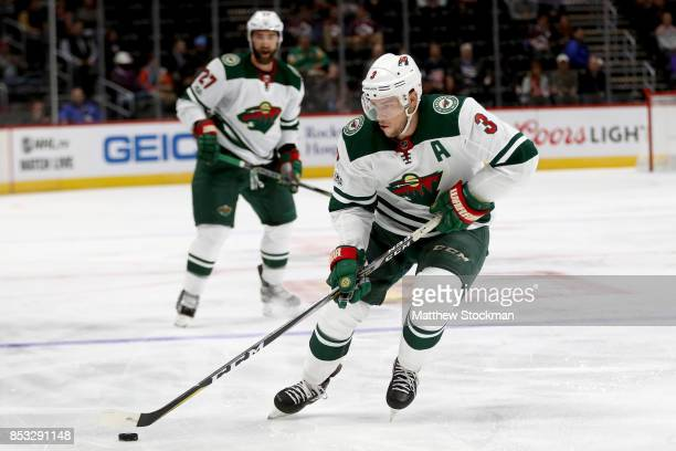 Charlie Coyle of the Minnesota Wild advances the puck against the Colorado Avalanche at the Pepsi Center on September 24 2017 in Denver Colorado
